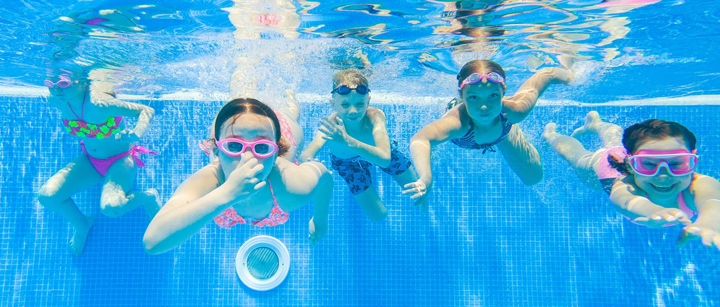Kids swimming underwater