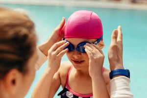 Girl putting on goggles