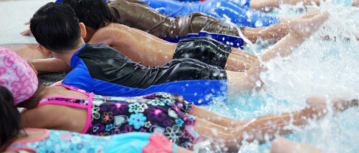 Kids splashing in swimming pool
