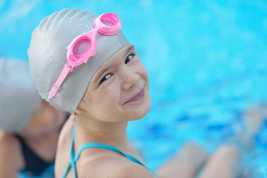 Young Girl Swimmer with Pink Goggles